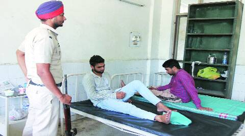 Moga encounter:  Rinku and Khushpinder Singh at Moga Civil Hospital. (Source: Express photo by Gurmeet Singh)