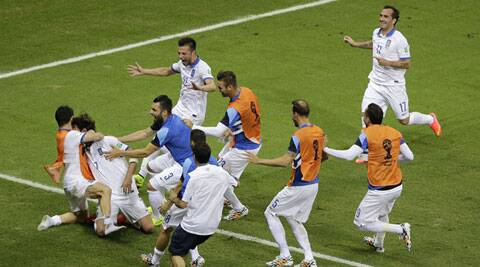 Greece's Giorgos Samaras, second from left, celebrates with his team after he scored on a penalty kick in the final minutes (Source: AP)
