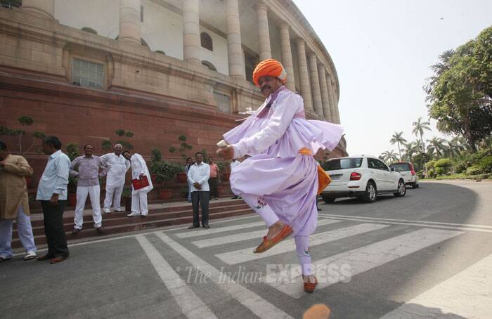 Gujarat MP from Surendranagar Devjibhai Fatehpura performed at Parliament house in New Delhi.  (Source: Express photo by Anil Sharma)