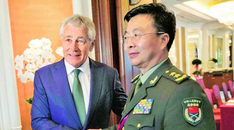US Defence Secretary Chuck Hagel (left) shakes hands with Lieutenant-General Wang Guanzhong, deputy chief of the general staff of the People's Liberation Army, in Singapore Saturday. ( Source: Reuters )