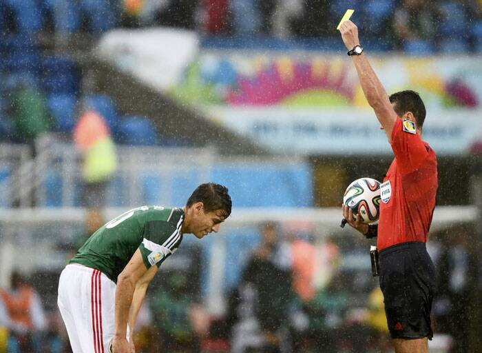 Mexico's Hector Moreno gets a yellow card in the 57th for  a rough tackle on Cameroon's M'Bia who showed great footwork to earn a free kick after the foul. (Source: Reuters)