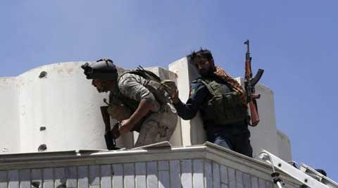 Afghan police repelling terrorists at the Indian consulate in Herat. (Reuters)