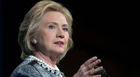 Embattled Clinton urges State Dept to release emails