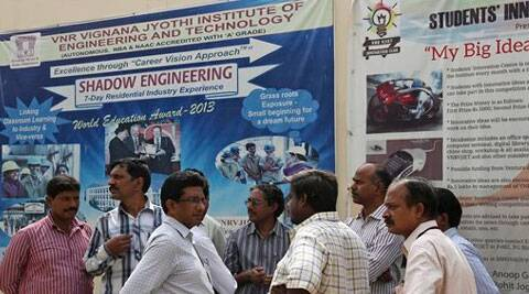 College staff working at VNR Vignana Jyothi Institute of Engineering and Technology, gather around after 24 of its students on a field trip near the mountain resort town of Manali were feared dead as they were swept away by water from Larji hydropower station. ( Source: AP )