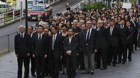 Hundreds of Hong Kong lawyers dressed in black march in silence in Hong Kong. (AP)