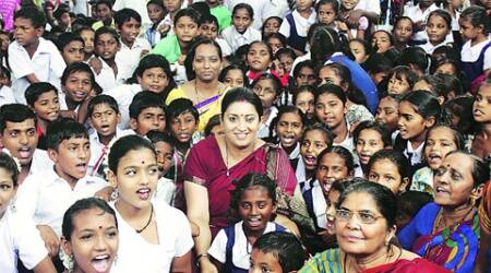 HRD minister Smriti Irani with students and faculty members at Kudasan Primary School in Gandhinagar on Friday. (Express Photo: Bhavesh Ravat)