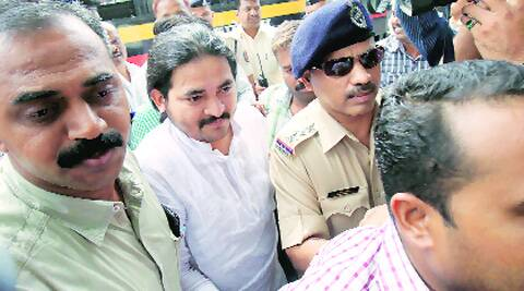 Desai being taken to a Pune court on Wednesday. The court sent him to one day police custody.Arul Horizon