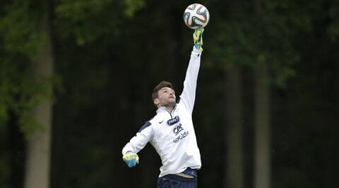 France's captain Hugo Lloris jumps to catch the ball during a training session ahead of the World Cup. (Source: Reuters)