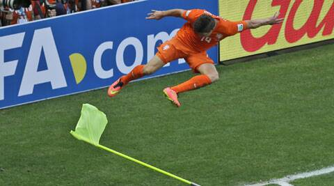 Netherlands's Klaas-Jan 'The Hunter' Huntelaar kicks a corner flag to celebrate the winner against Mexico in Fortaleza on Sunday. (Source: AP)
