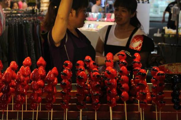 Strawberries and tomatoes dipped in sugar syrup. More low light. An image from the Shilin night market.