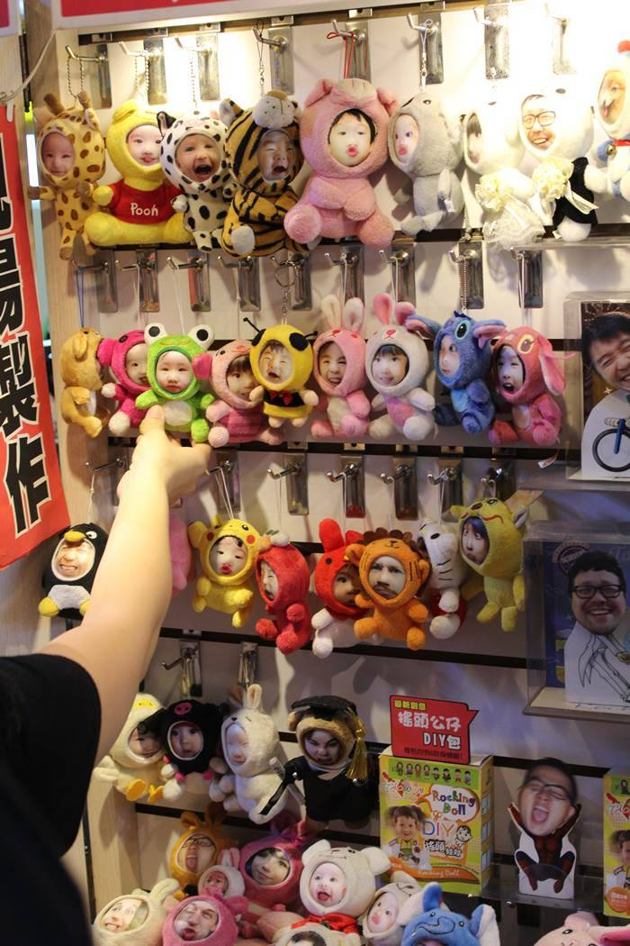 Your face on the doll of your choice. An image from the Shilin night market.
