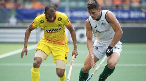 India's Sunil Sowmarpet (yellow) tussles for the ball with Australia's Jeremy Hayward (white)