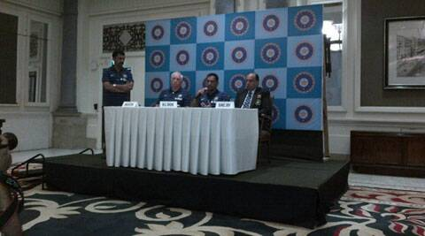 Mahendra Singh Dhoni and Duncan Fletcher at a press conference in Mumbai ahead of India's tour of England. (Source: IE Photo)