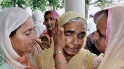 Amritsar: A relative is consoled during a prayer meeting for the Indian workers stranded in Iraq, at Baba Budha Ji Sahib Gurdwara at Kathunangal in Amritsar on Tuesday. (Source: PTI)