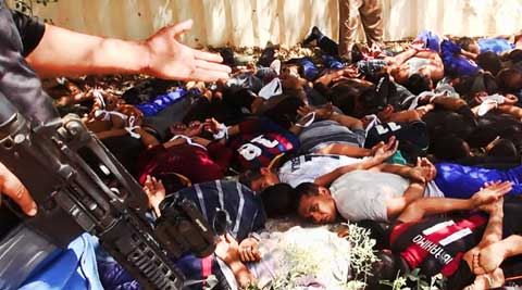 Islamic militant group that seized much of northern Iraq has posted photos that appear to show its fighters shooting dead dozens of captured Iraqi soldiers in north of Baghdad. (Source: AP)