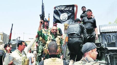 Security forces hold up a flag of ISIL they captured during an operation to regain control of Dallah Abbas, the capital of Iraq's Diyala province; (below) a man, who fled with his family from Mosul, at a camp for displaced Iraqis outside Irbil. (Source: AP)