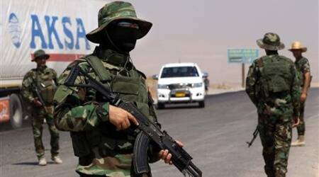 Kurdish security forces take their positions at a checkpoint, on a highway between the Iraqi city of Mosul and the Kurdish city of Irbil, in Khazer area northern Iraq. (Source: AP)