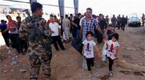 After seizure by militants, some 500,000 Iraqis flee Mosul: IOM