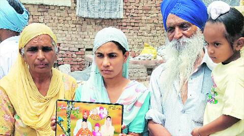 Family members of Gurcharan Singh, who is one of the 40 youths abducted in Iraq, in Bhoewal village of Amritsar on Wednesday. Source: Rana Simranjit Singh