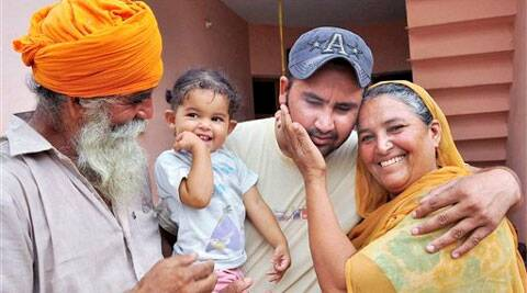 Harjinder Singh who returned from Iraq, with his family members in Khatoli village in Patiala on Monday. Source: PTI Photo