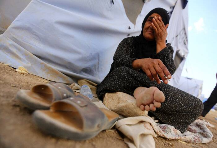 n Iraqi refugee woman from Mosul sits outside her family's tent at Khazir refugee camp outside Irbil. The Islamic State of Iraq and the Levant, the al-Qaida breakaway group, took over much of Mosul in Iraq and then swept into the city of Tikrit further south. (Source: AP)