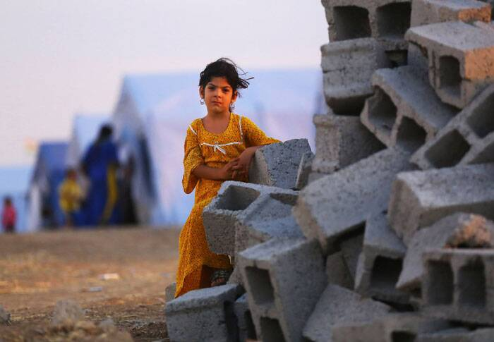 A child stands in the refugee camp area. (Source: AP)