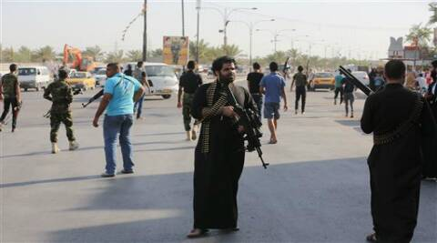 Shiite tribal fighters deployed armed in the northwest Baghdad's Shula neighborhood, Iraq (Source: AP)