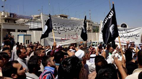 Demonstrators chant pro-al-Qaida-inspired Islamic State of Iraq and the Levant (ISIL) as they wave al-Qaida flags in front of the provincial government headquarters in Mosul. (AP)
