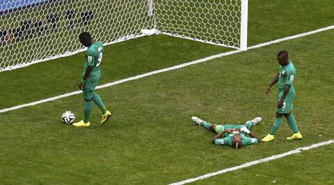 Ivory Coast players react after Colombia scored their second goal. (Source: Reuters)