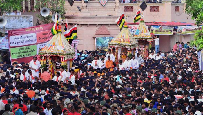 After setting off from the over 400 year-old iconic temple, the rathyatra will traverse through about 14 kilometre route in the city.<br /><br />Devotees gather at Jagannath Temple for Lord Jagannath's 137th Rath Yatra in Ahmedabad. (Source: PTI)