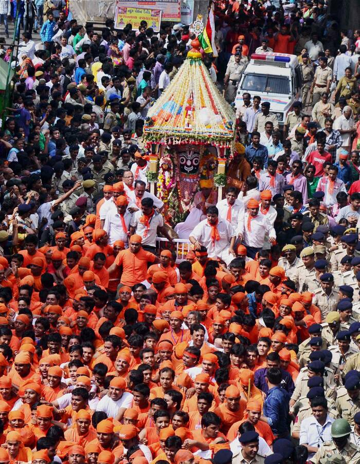 The procession halts at Saraspur, where the local people offer 'Maha Bhoj' to the entire entourage. Saraspur area of the city has religious significance as it is considered as Lord Jagannath's maternal home.<br /><br />Devotees clad in saffron and white participate in Lord Jagannath's 137th Rath Yatra. (Source: PTI)