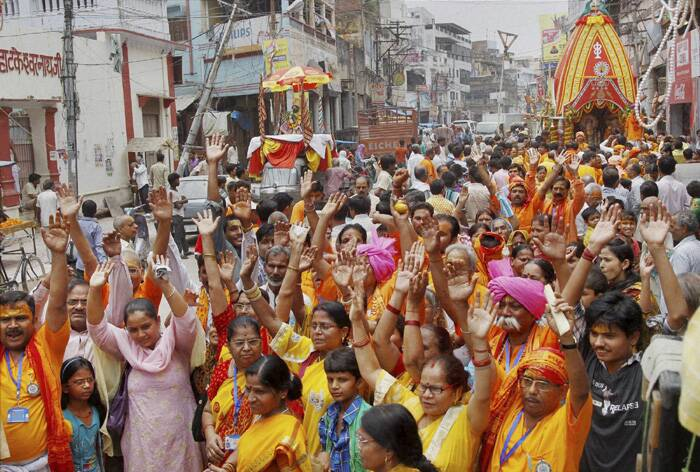 Devotees chant holy slogans before the commencement of Lord Jagannnath Rath Yatra in Allahabad. (Source: PTI)