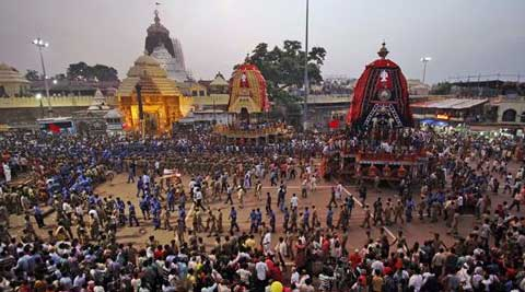 Devotees and paramilitary forces pull chariots to set in front of the Lord Jagannath temple, on the eve of the annual Rath Yatra, (Source: AP Photo)