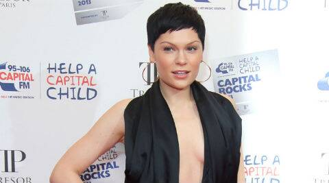 Jessie J posted pictures from her bed wearing just a white sheet. (source: AP)