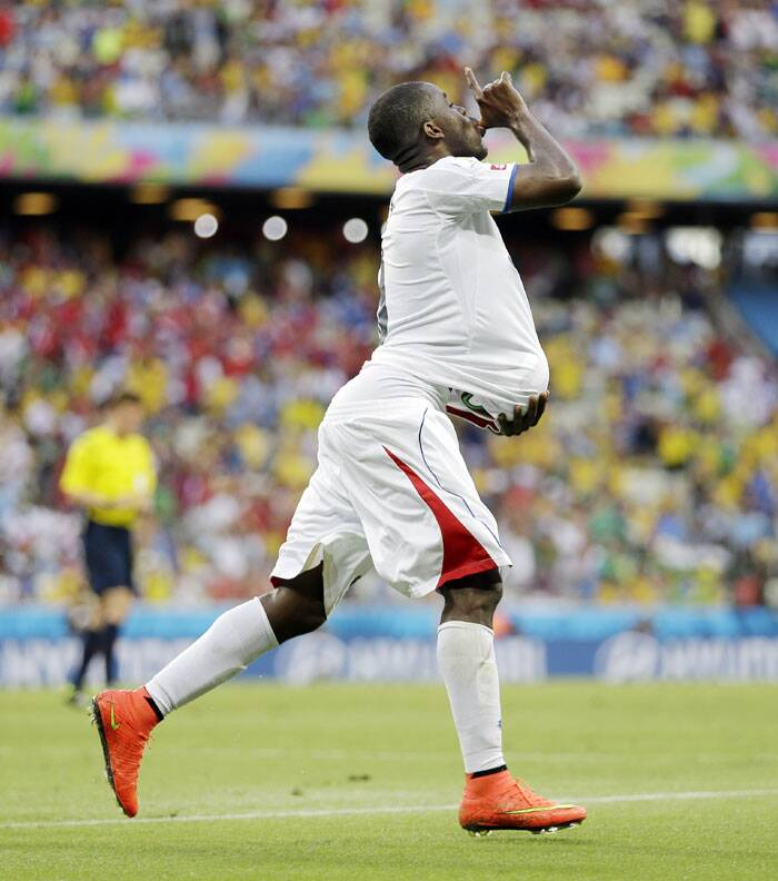 Costa Rica's Joel Campbell celebrated becoming a dad and scoring in his team's upset 3-1 victory over Uruguay. (Source: AP)