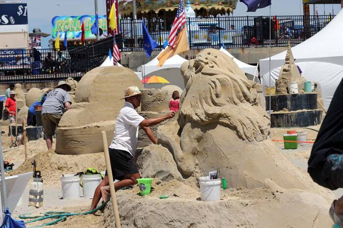 Jooheng Tan, of Singapore, works on his sand creation during the DO AC Sand Sculpting World Cup. Each competitor got to use 500 tonnes of sand.  (Source: AP)