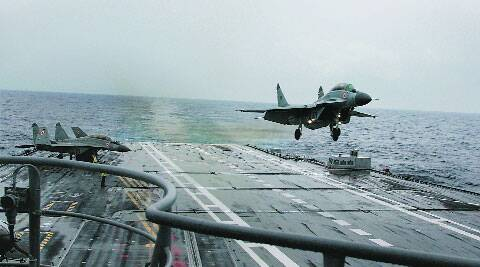 A jet takes off  from INS Vikramaditya.