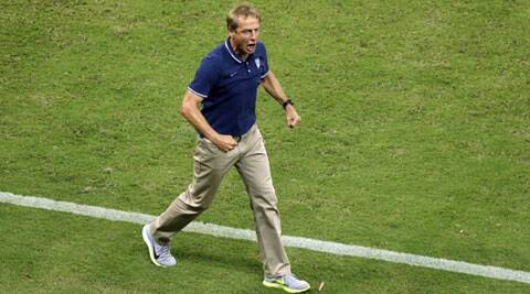United States' head coach Juergen Klinsmann celebrates a goal during his side's Group G match against Portugal in Manaus. (Source: AP)