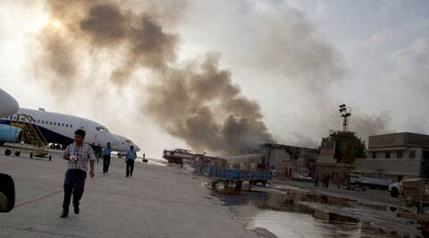 Smoke rises above the Jinnah International Airport where security forces battled militants for five hours before killing them. (Source: AP)
