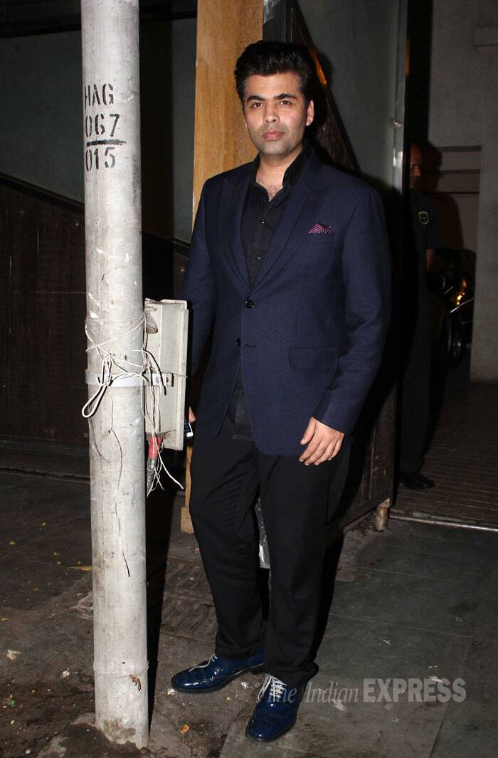 Director Karan Johar, who has recently patched up with Bedo, was suave in formals. The director opted for a blue blazer over a black shirt and trousers. (Source: Varinder Chawla)
