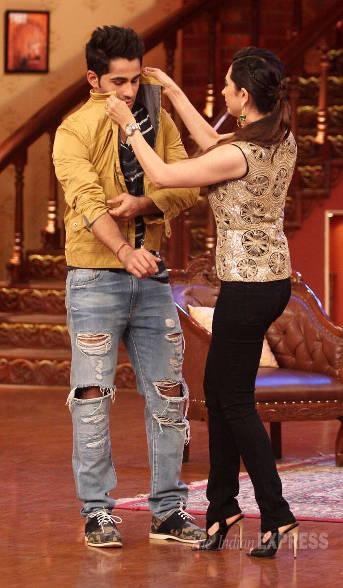 Playing the typical elder sister, Karisma adjusts Armaan's collar. (Source: Varinder Chawla)