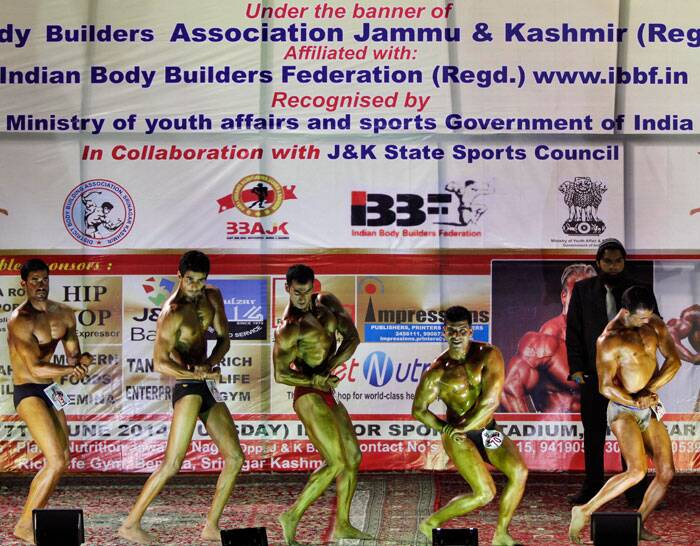 Kashmiri body builders display their muscles at a District Body Building Championship in Srinagar on Tuesday. <br /> Dozens of Kashmiri youth participated in the competition to choose Mr. Kashmir on Tuesday. (Source: AP)