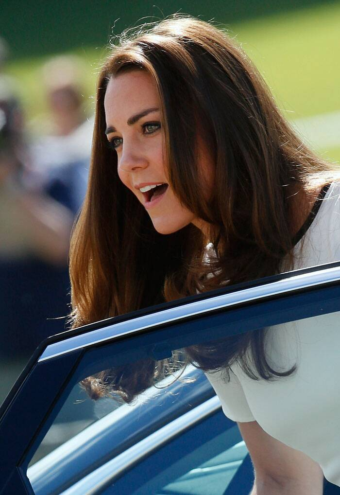 Golden lady Kate Middleton is regal in McQueen at Palace garden party