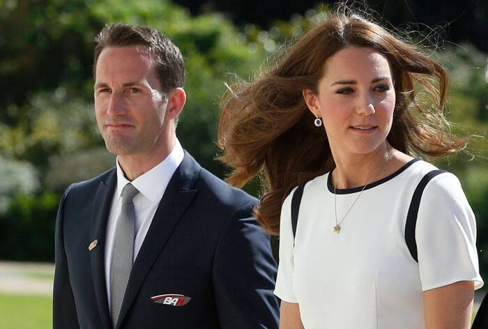 Royally yours! Kate Middleton impresses in white for a solo appearance