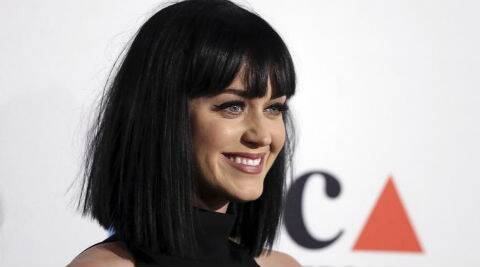 Katy Perry was spotted kissing and cuddling Rob Ackroyd at an afterparty. (Source: AP)