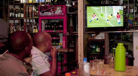 Kenyan football fans are seen here watching the World Cup at a local pub. The police officials hope the dip is crime rate lasts longer than the World Cup. (Source: AP)