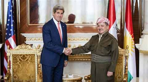 Kurdish President Massoud Barzani, right, shakes hands for photographers with U.S. Secretary of State John Kerry at the presidential palace in Irbil on Tuesday. (Source: AP)