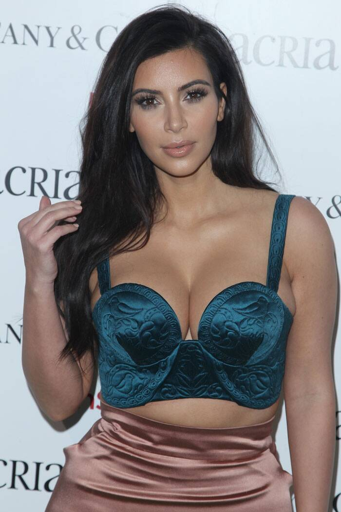 Kim Kardashian turned heads in a green push-up bralet that showed ample cleavage. The mother-of-one paired the cropped top with a peach coloured satin skirt.  (Source: AP)