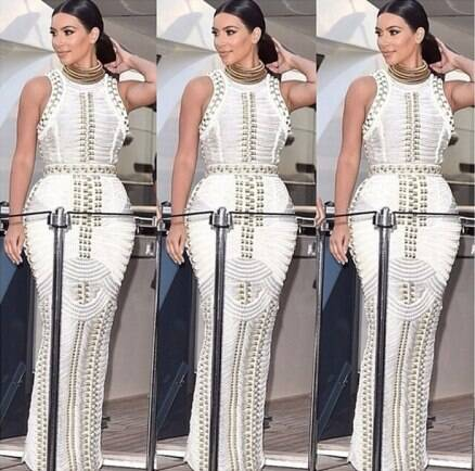 Kim Karadashian stuns in ivory and gold dress made of rope