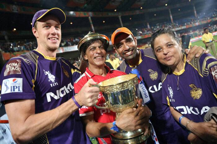 KKR co-owner Shah Rukh Khan (second left) could not have wished for a better result as the king of Bollywood was got the best gift from KKR players. Khan cheered for KKR throughout the match and was unable to control his emotions after the win. He joined the team for the victory lap and posed with the trophy. Morne Morkel (L) shares the joy with Khan and team-mate Robin Uthappa (second right.) (Source: BCCI/IPL)